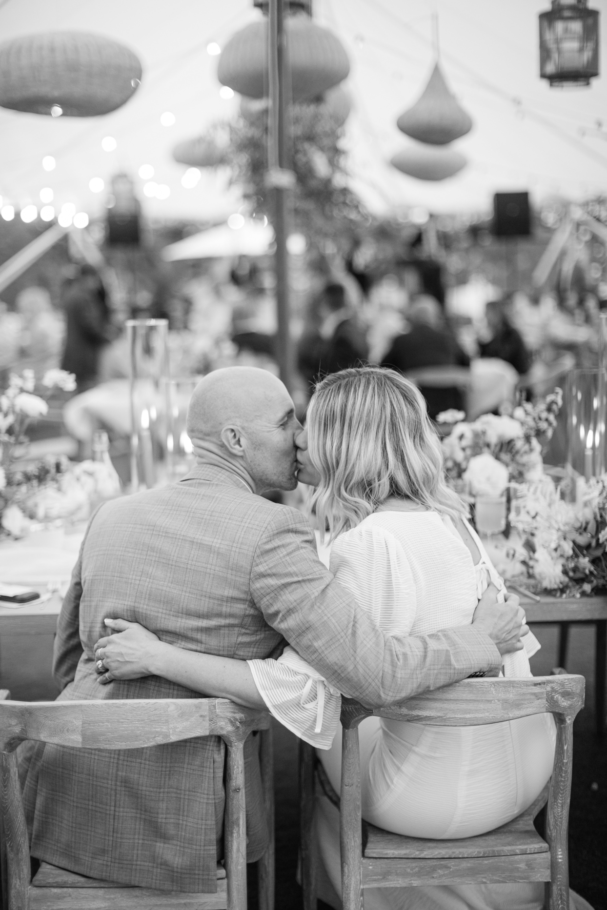 bride and groom sharing kiss during wedding reception