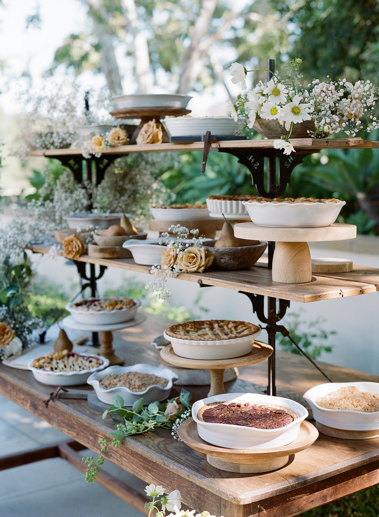 tiered table with various pies on display