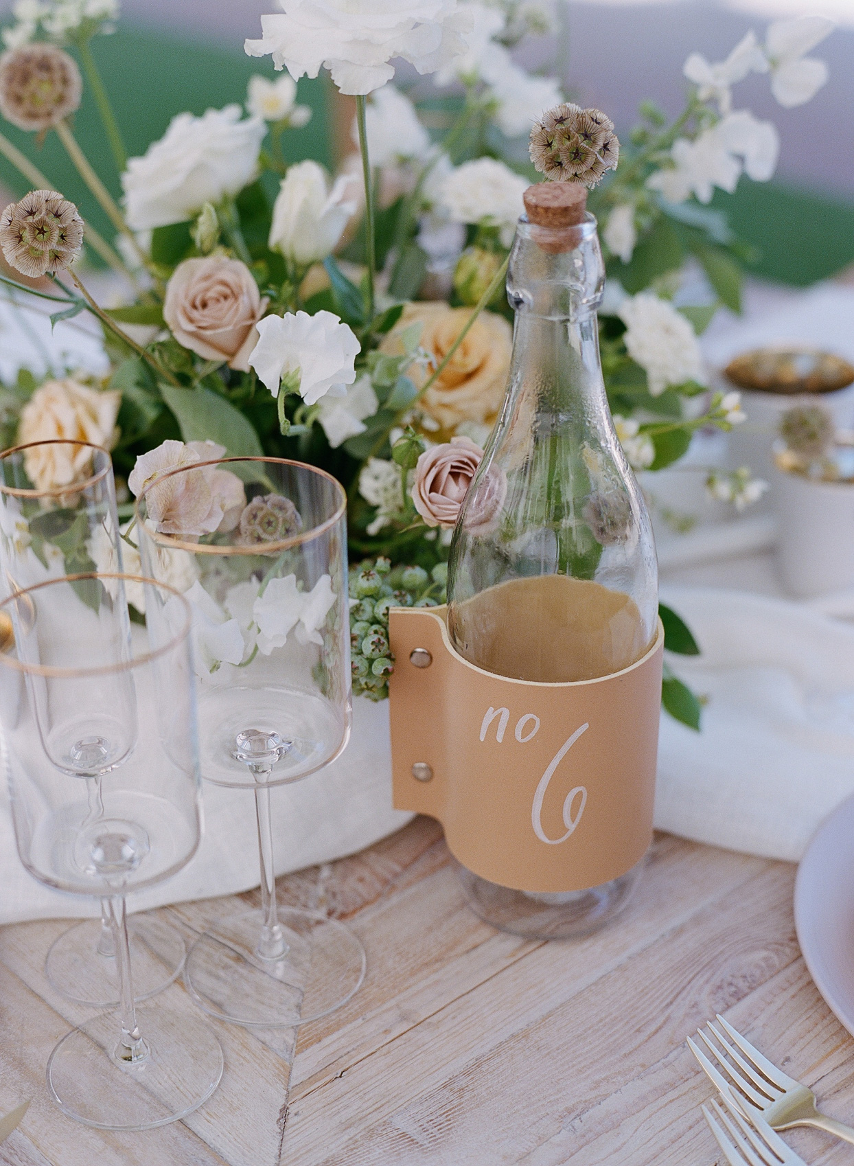 leather wrapped glass bottle table numbers