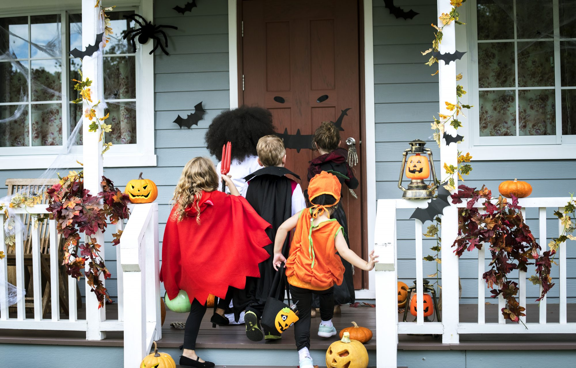 Young kids trick or treating during Halloweenkids-treak-or-treating-getty-0921