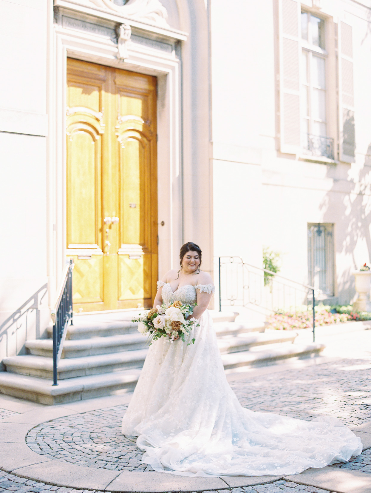 bride wearing an off the shoulder a-line wedding gown