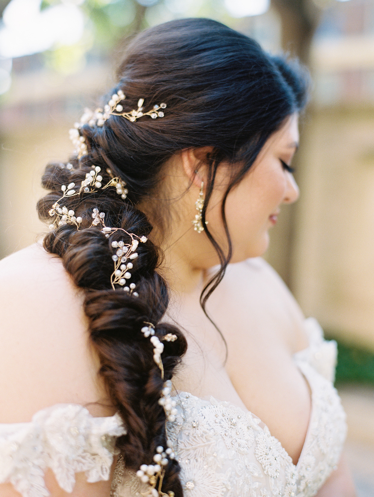 bride with braided hair with pearl hair accessory