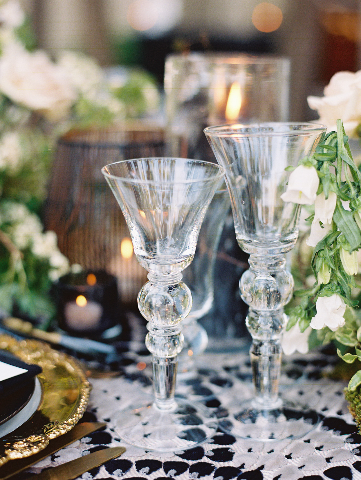 reception glassware with gold utensils