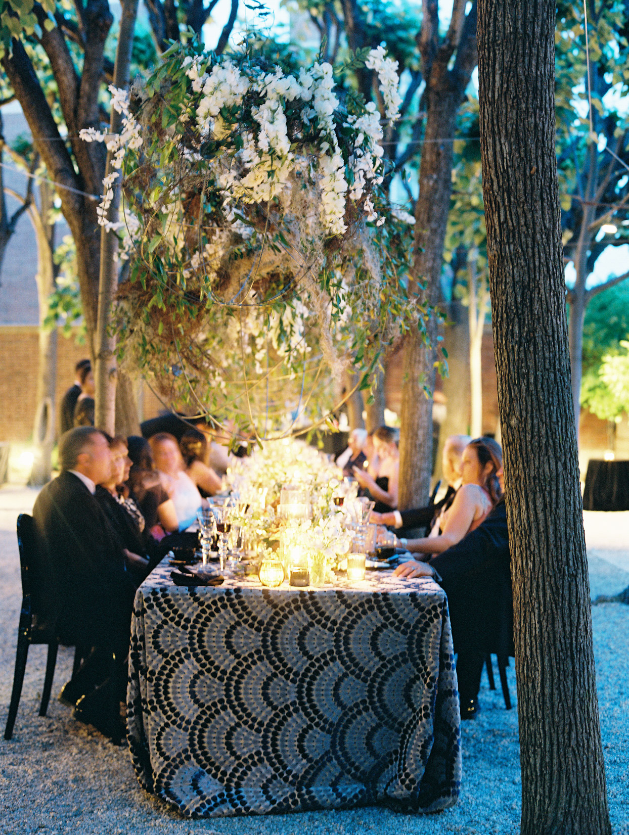 outdoor wedding dinner reception with candles and florals