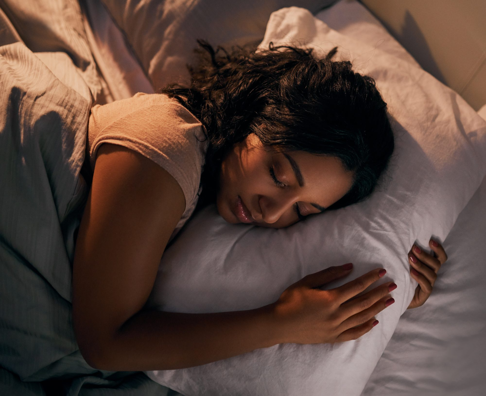 woman sleeping soundly in bed at night time