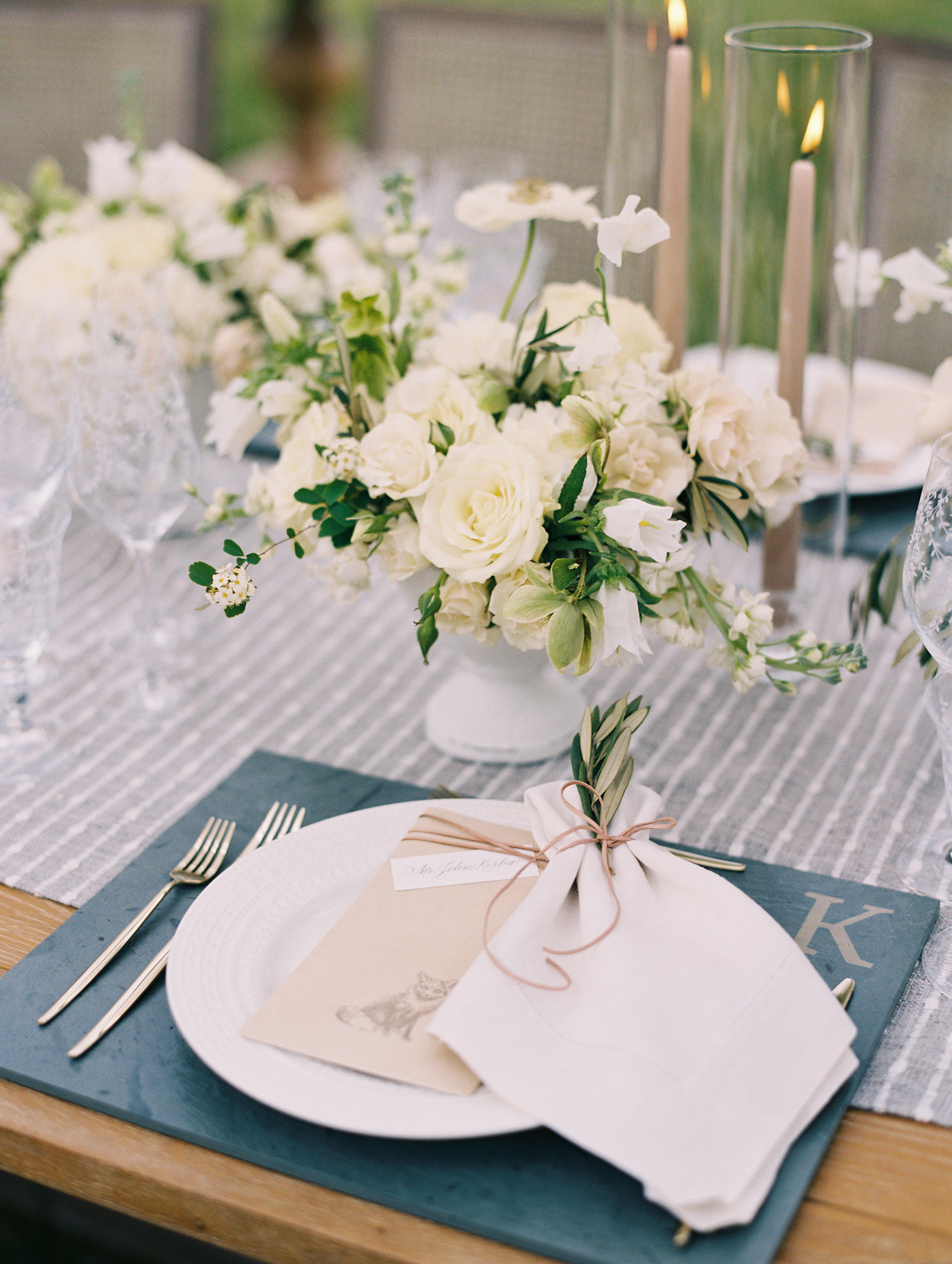 white plates on blue gray placemats