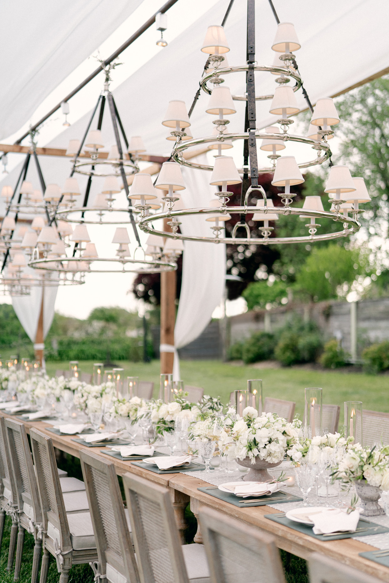 low white floral wedding reception table decor with candles