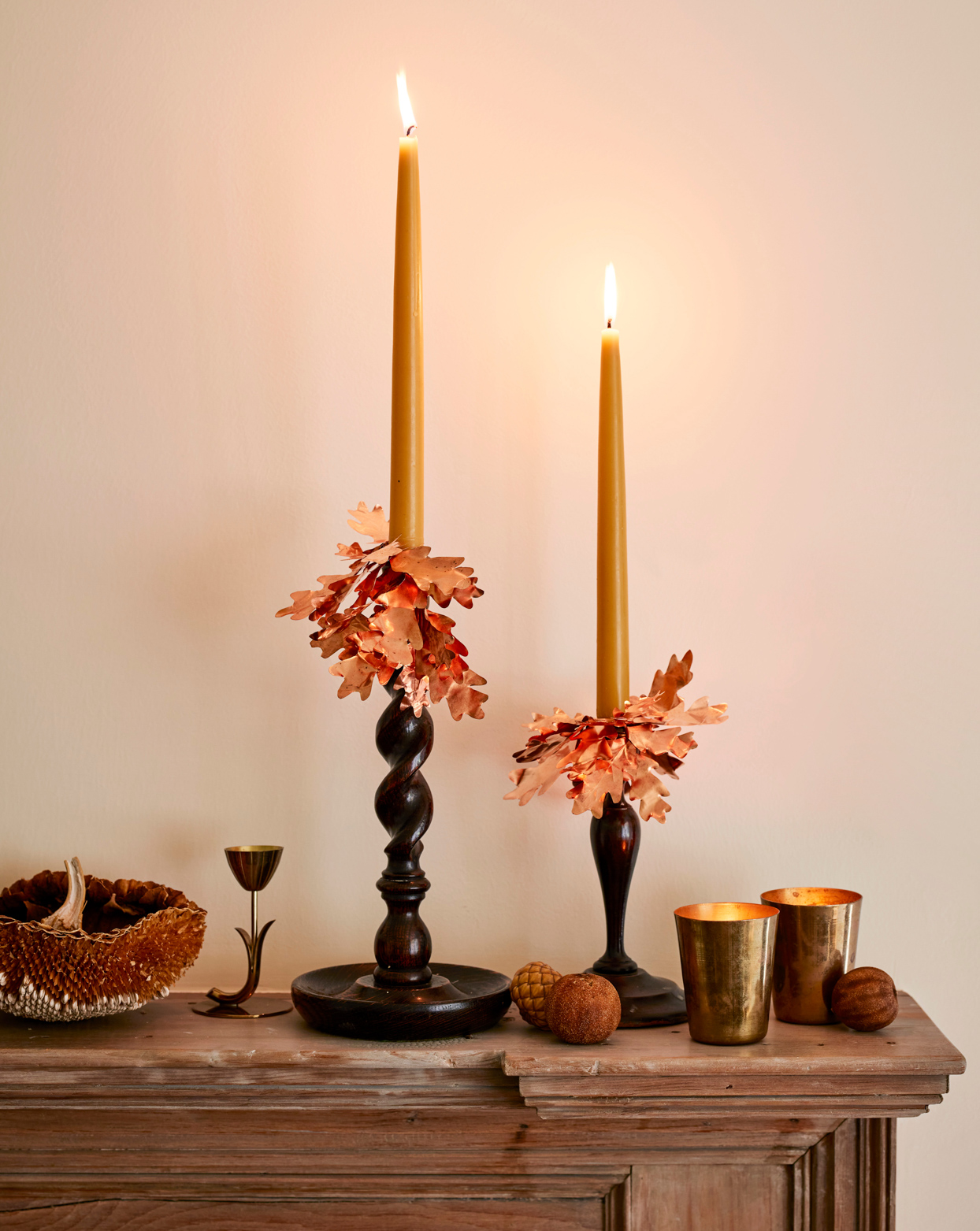 candles with autumn leaf adornments