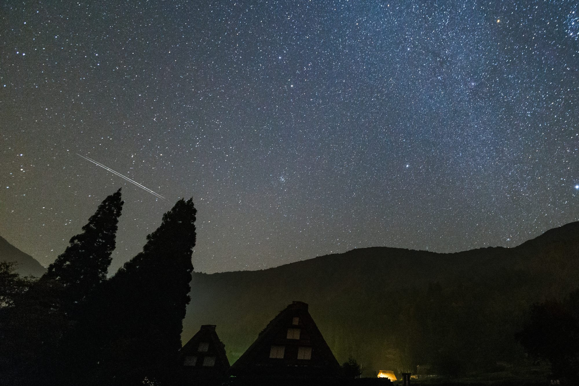 orionid meteor shower over mountains in japan