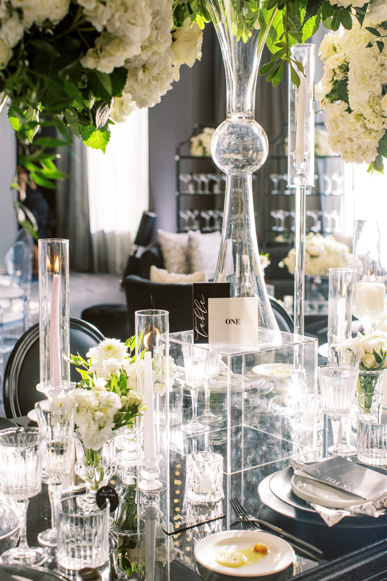 black and white themed table numbers and decor details