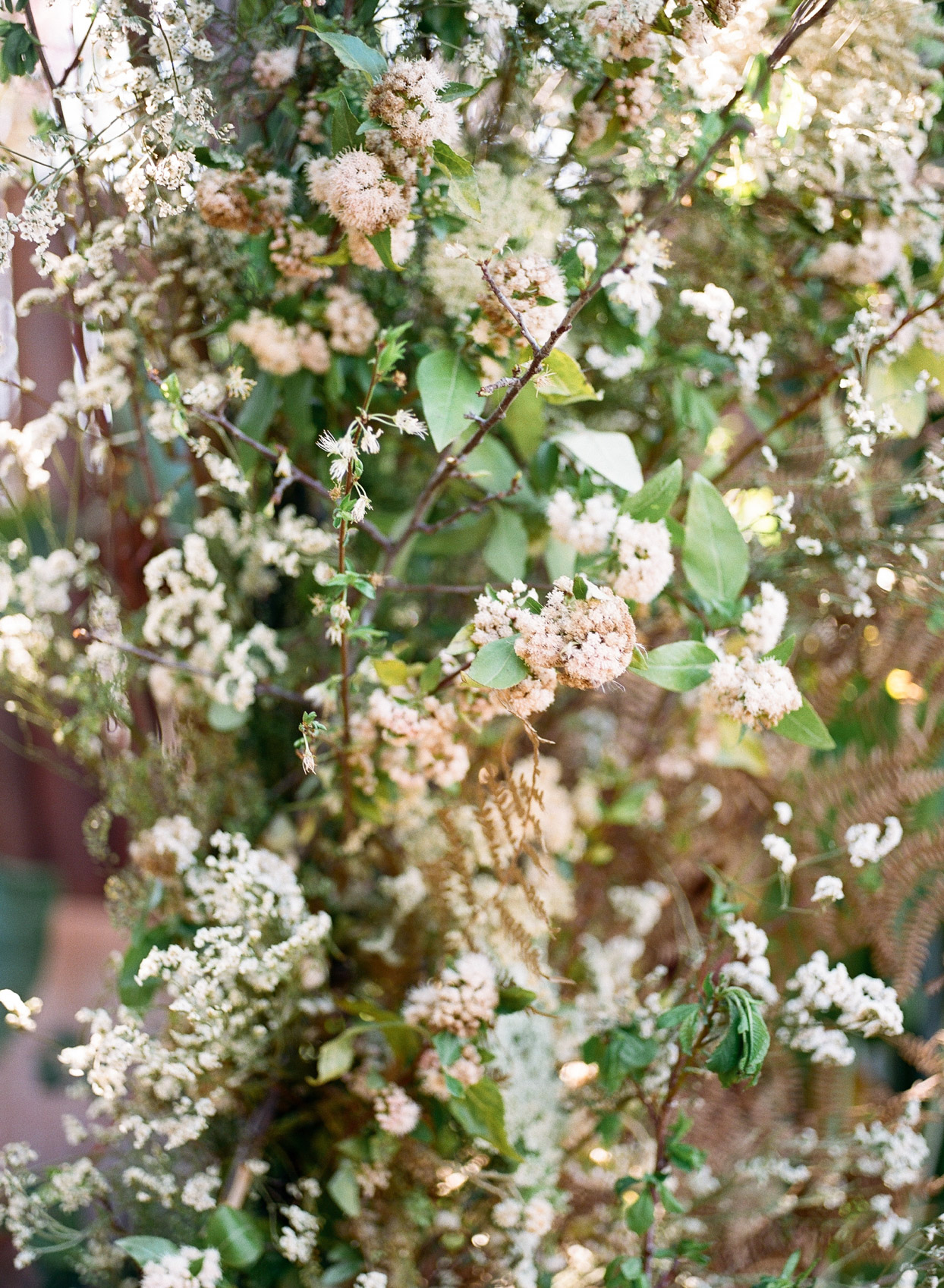 white floral detail shot of wedding arch