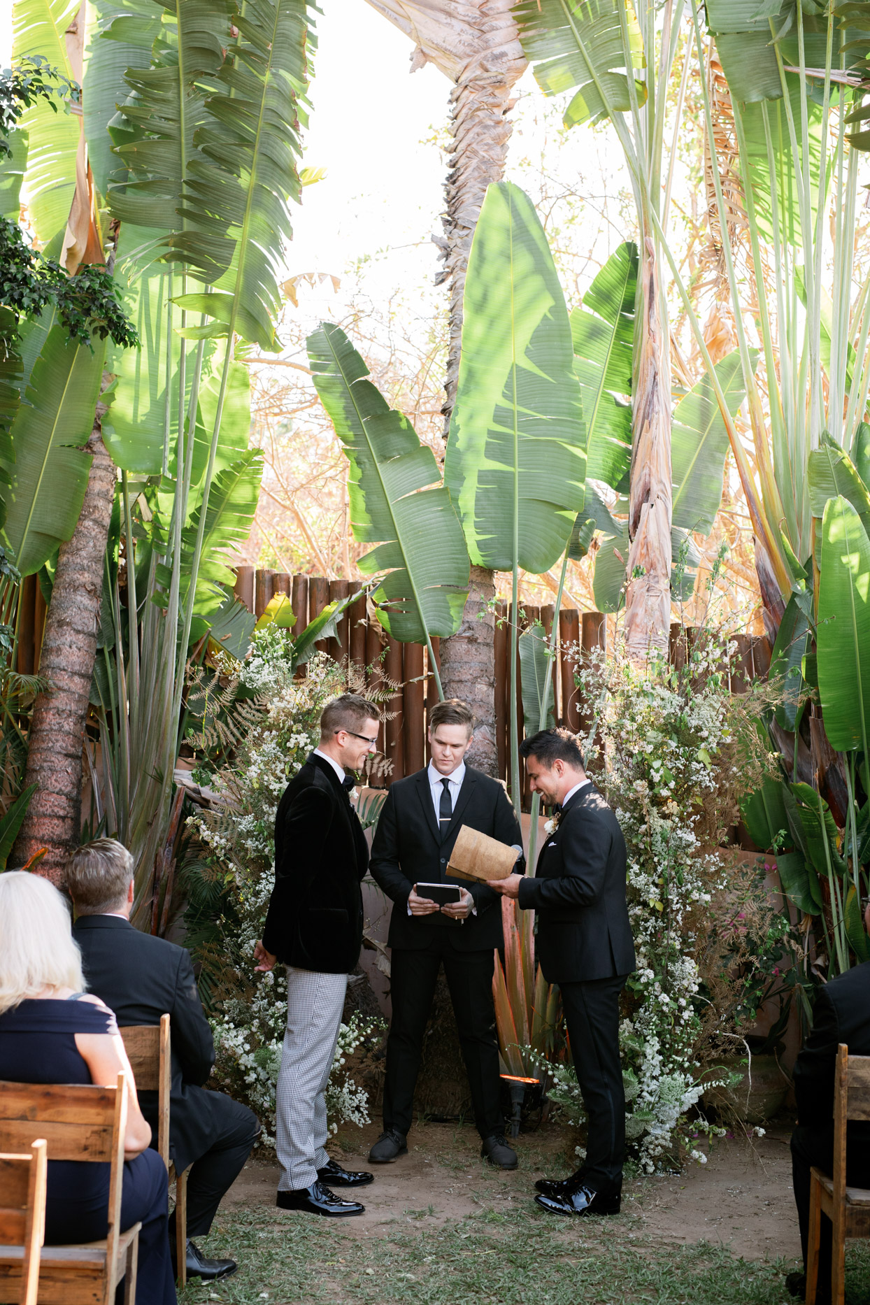 couple sharing vows during outdoor wedding ceremony