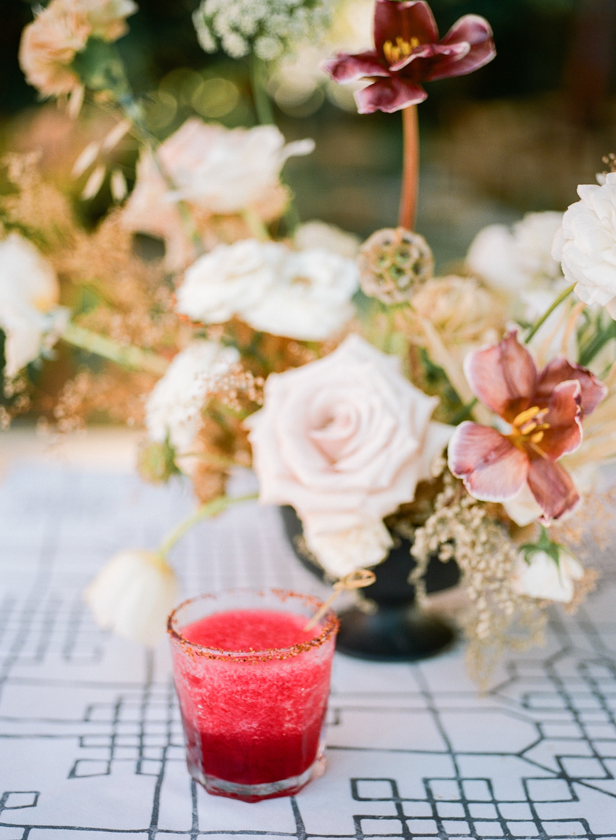 custom cocktail on table with flowers for wedding
