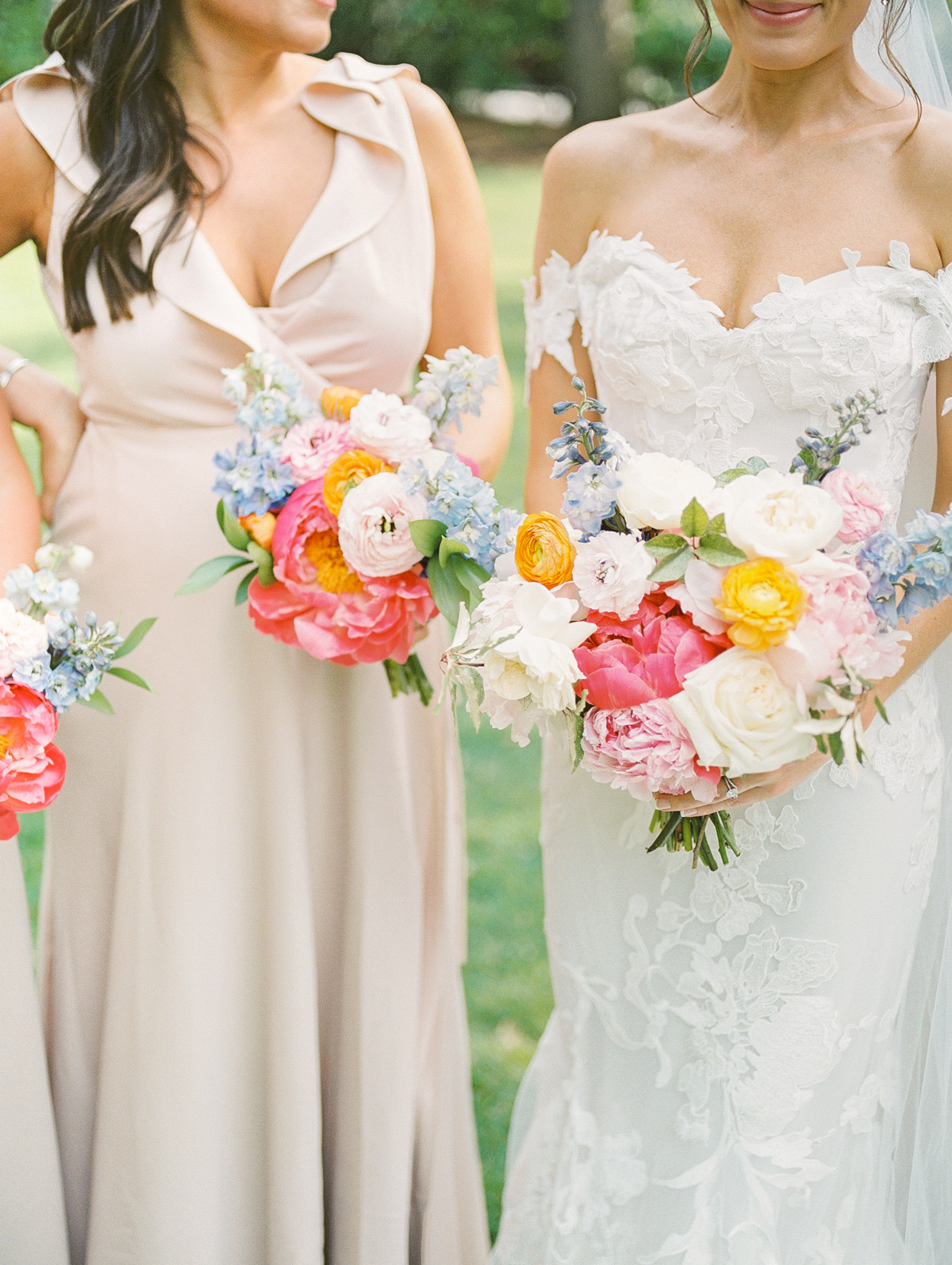 bouquets of pink peonies, white roses, and yellow ranunculus