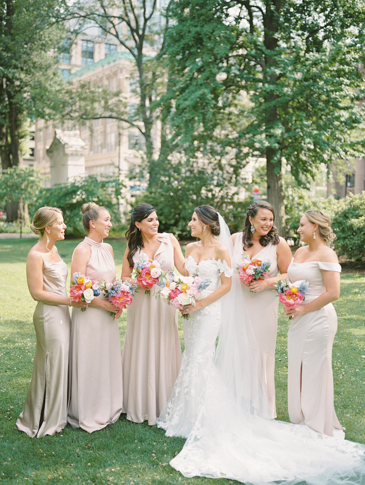 bridesmaids in champagne tone floor-length satin gowns