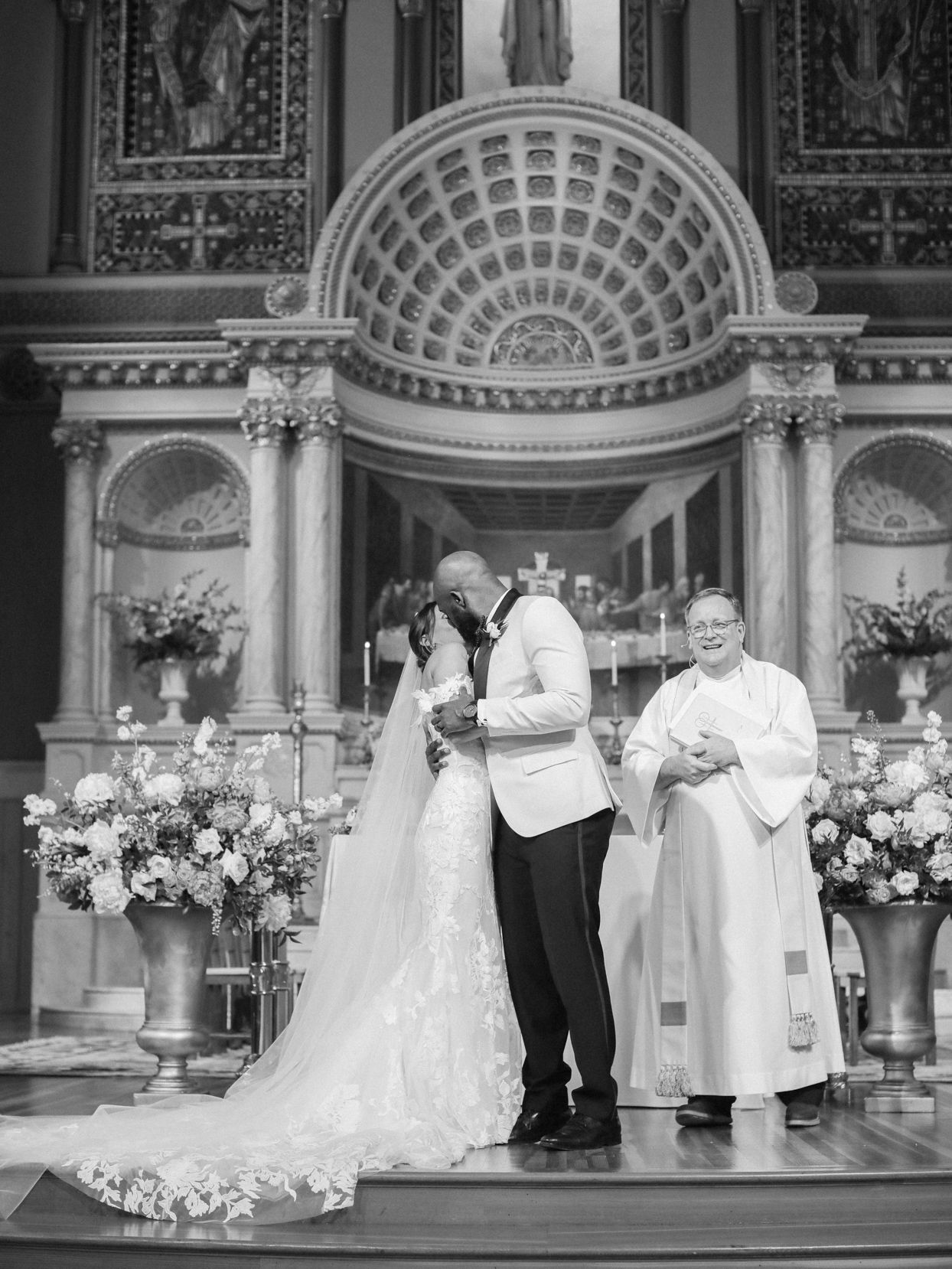bride and groom kissing at the end of ceremony