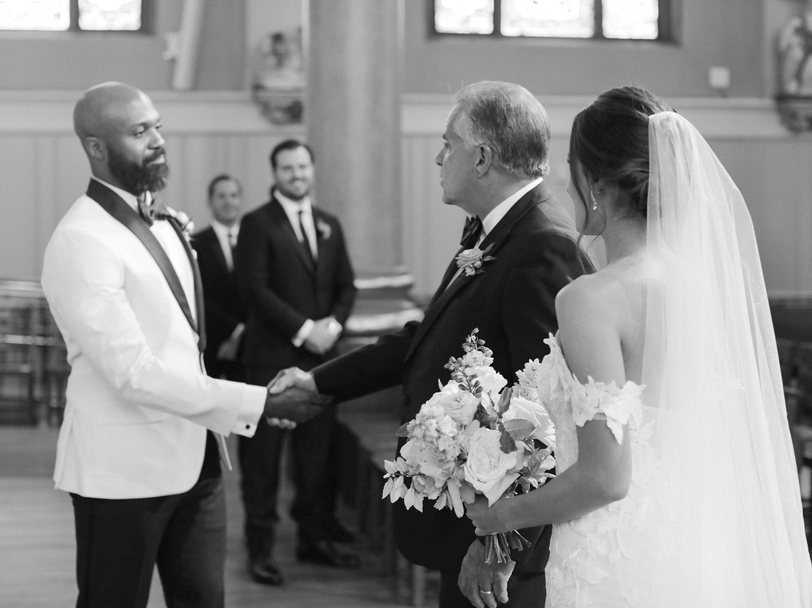 groom shaking hands with bride's father