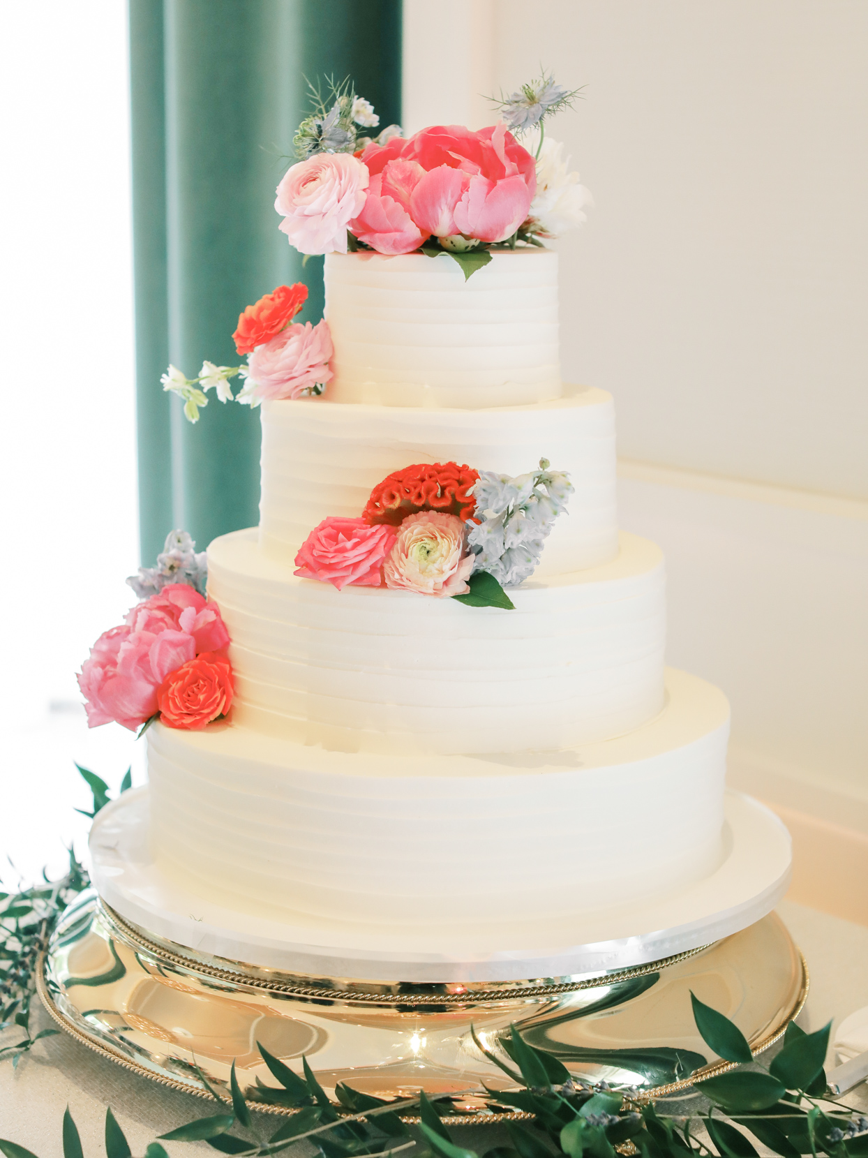 A four-tier cappuccino torte cake with peonies