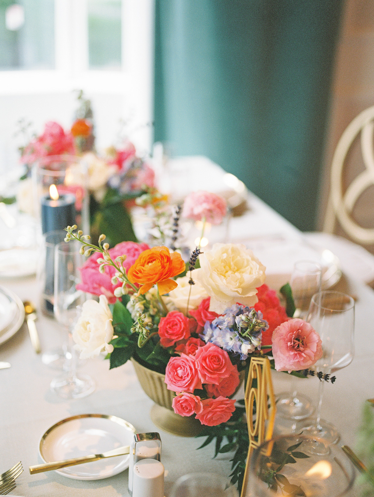 colorful floral centerpieces at wedding reception