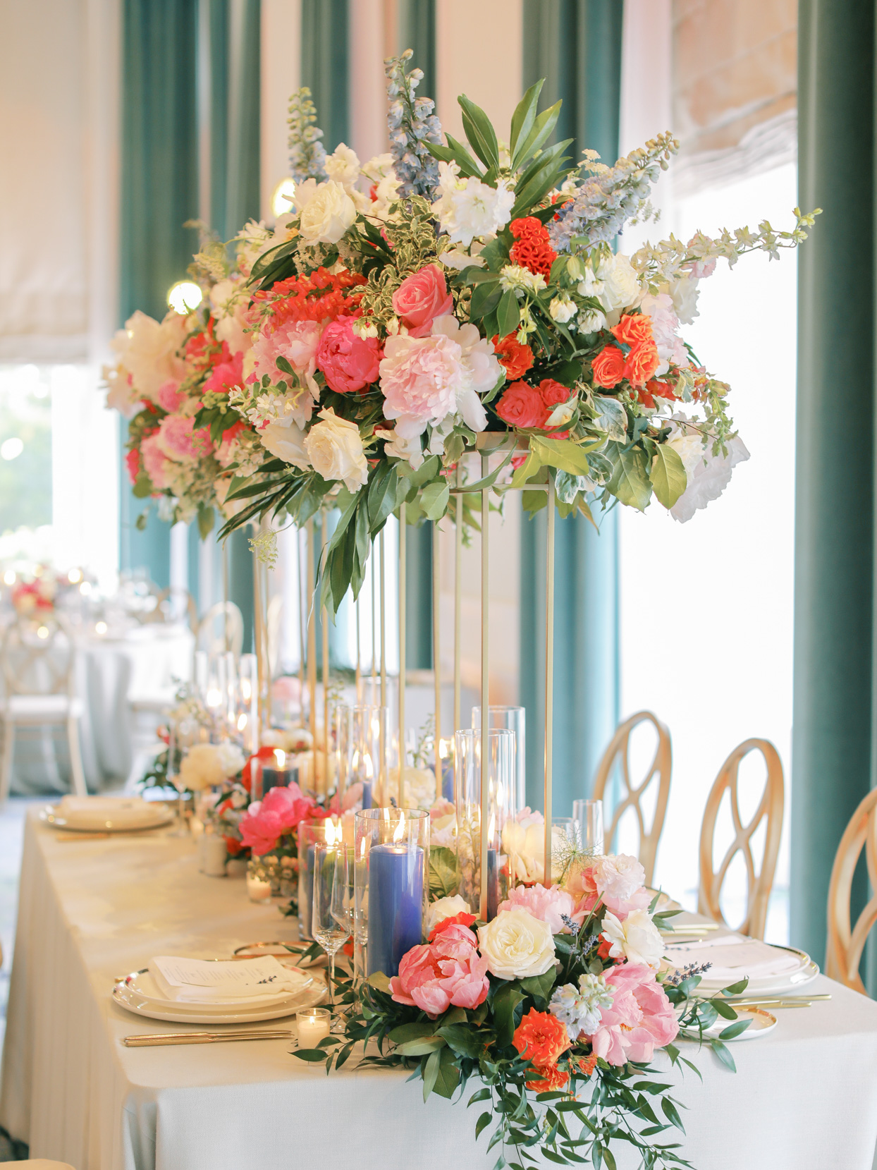 raised floral centerpieces at wedding