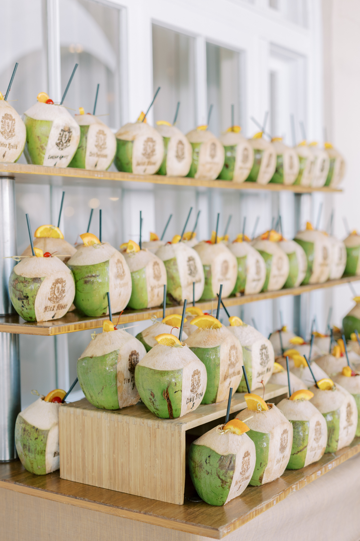 wedding ceremony coconut drinks with oranges and straws