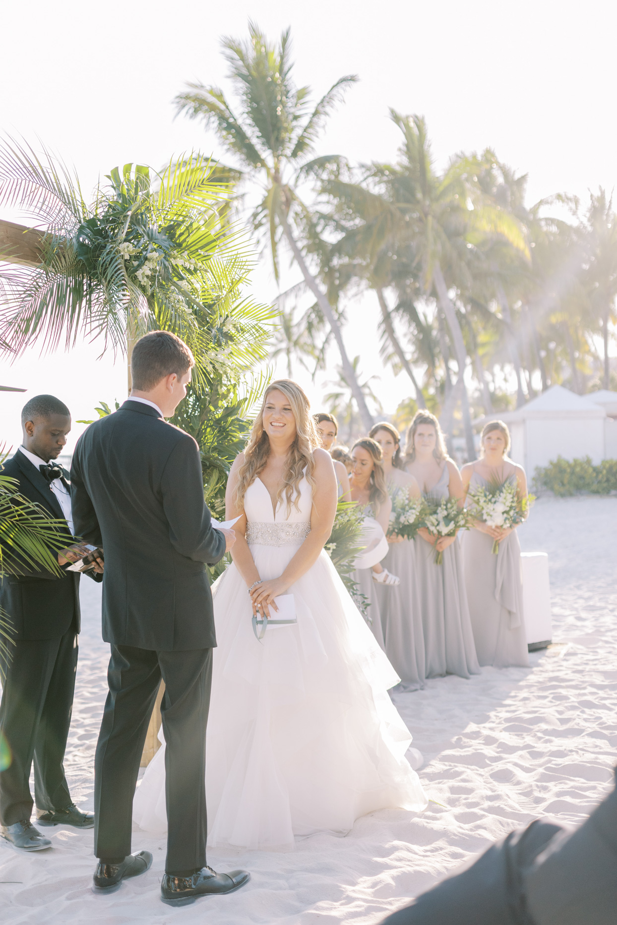 bride smiling at groom during wedding ceremony vows