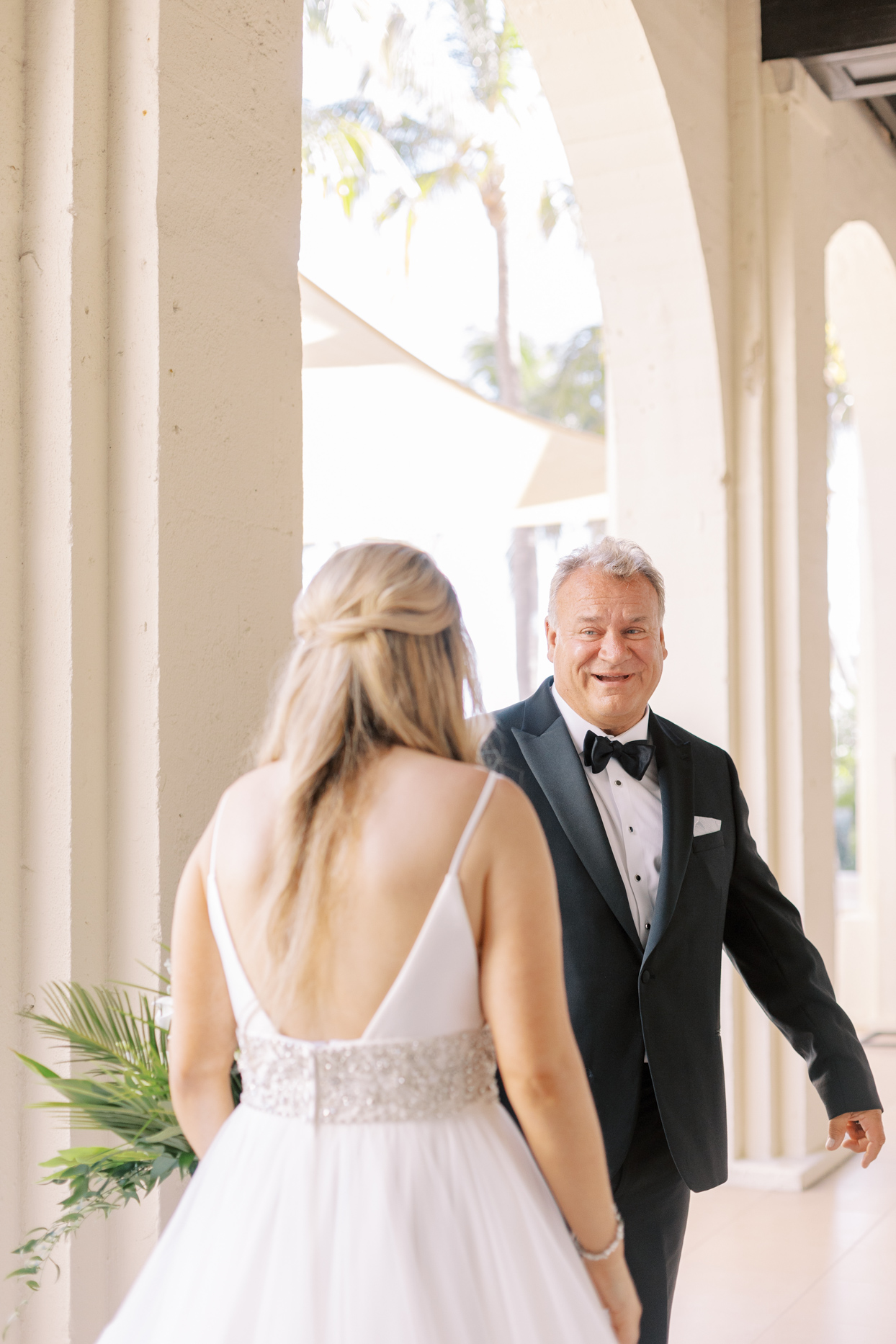 dad smiling at bride during first look