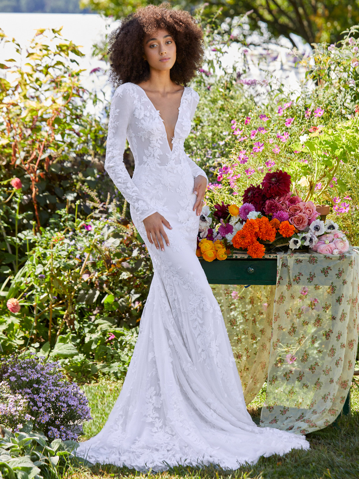 Ines Di Santo plunging v-neck lace long sleeve wedding dress fall 2022