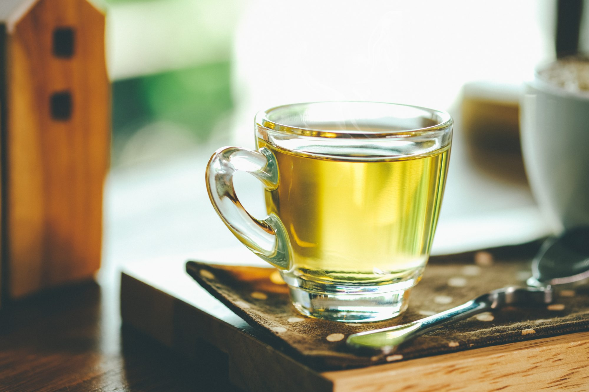 Close-Up Of Green Tea In Cup On Table
