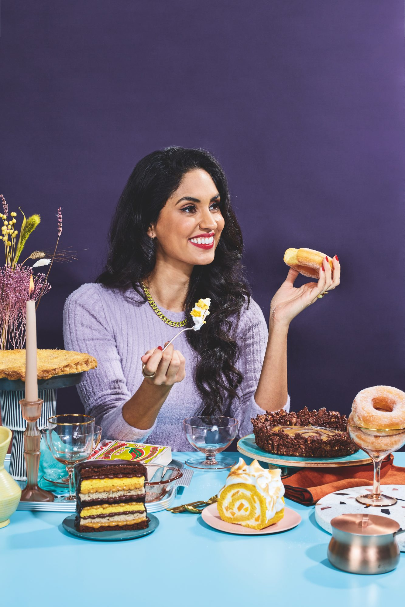 pastry chef ravneetgill at table to with baked goods