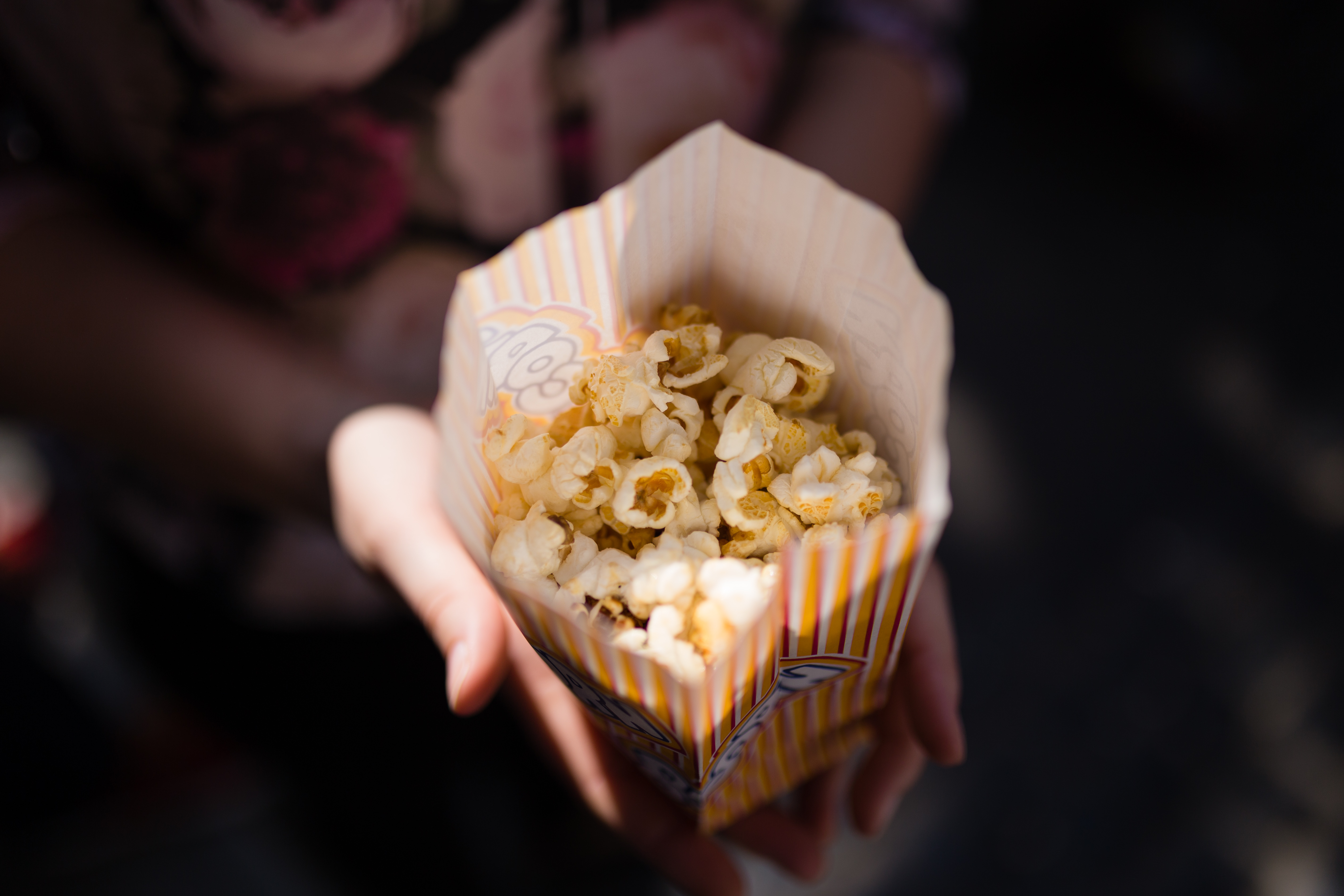 Woman eating low-sodium popcorn salty snack