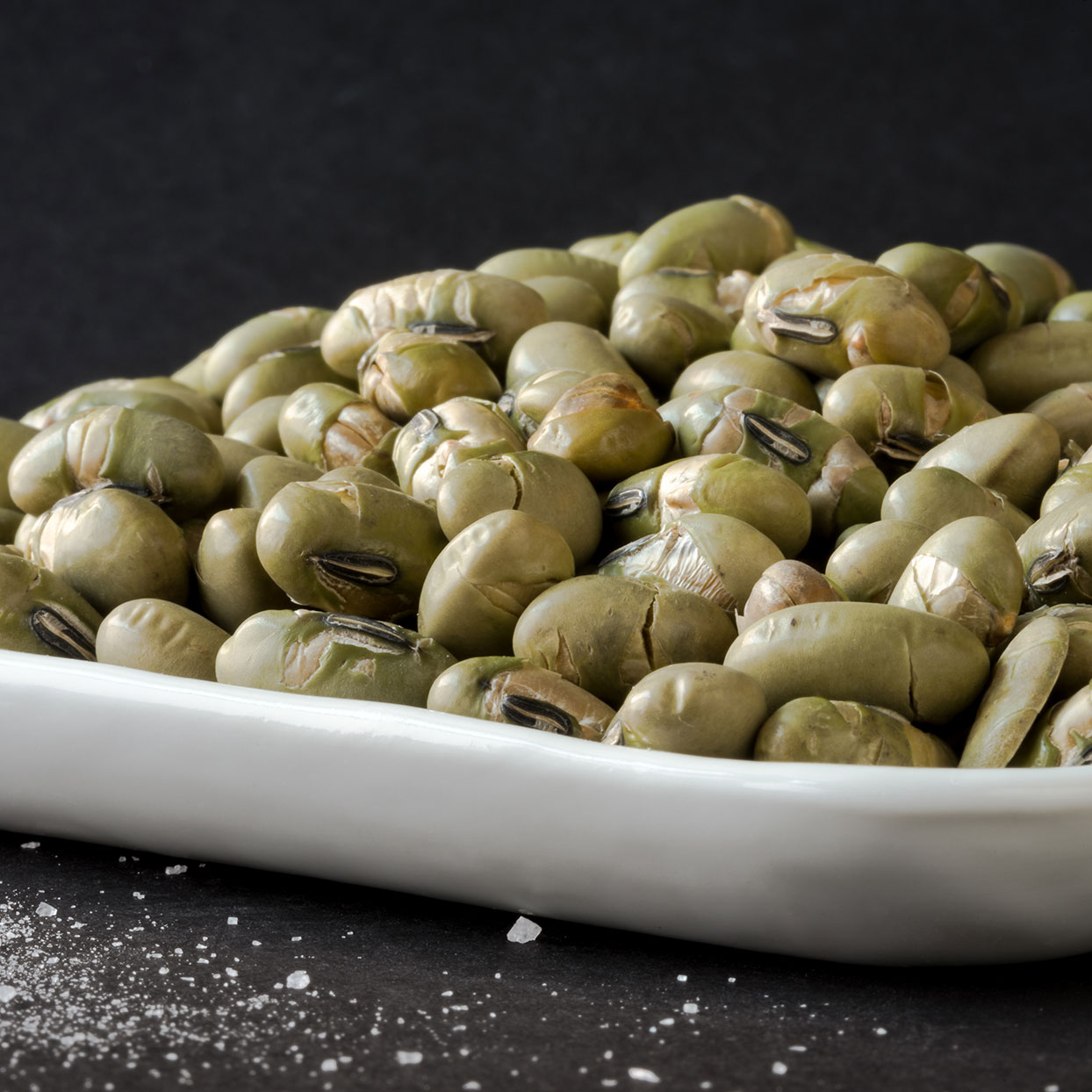 The Lowdown: (1/2 cup in shell with a dash of coarse salt) 90 calories, 4g fat, 168mg sodiumWhole green soybeans eaten out of the pod are a great source of cholesterol-lowering soy protein. A half-cup serving provides 3 grams of fiber and 7 1/2 grams of protein, plus a little calcium, iron, and vitamin C.