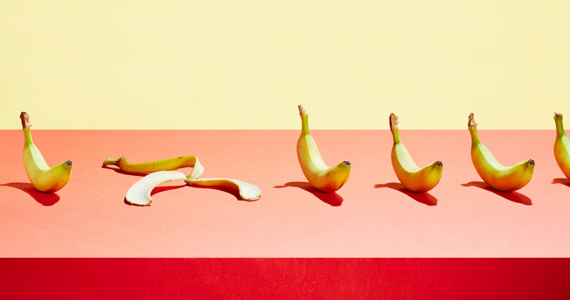 Banana_Peel_And_Bananas_In_A_Row