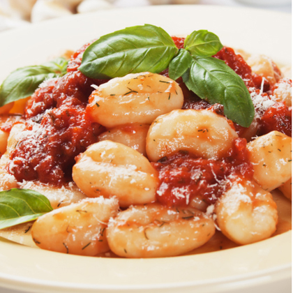 Gnocchi with Tomatoes, Green Olives, and Smoked Mozzarella