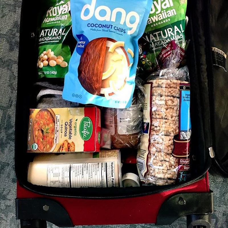 full suitcase of healthy snacks for travel