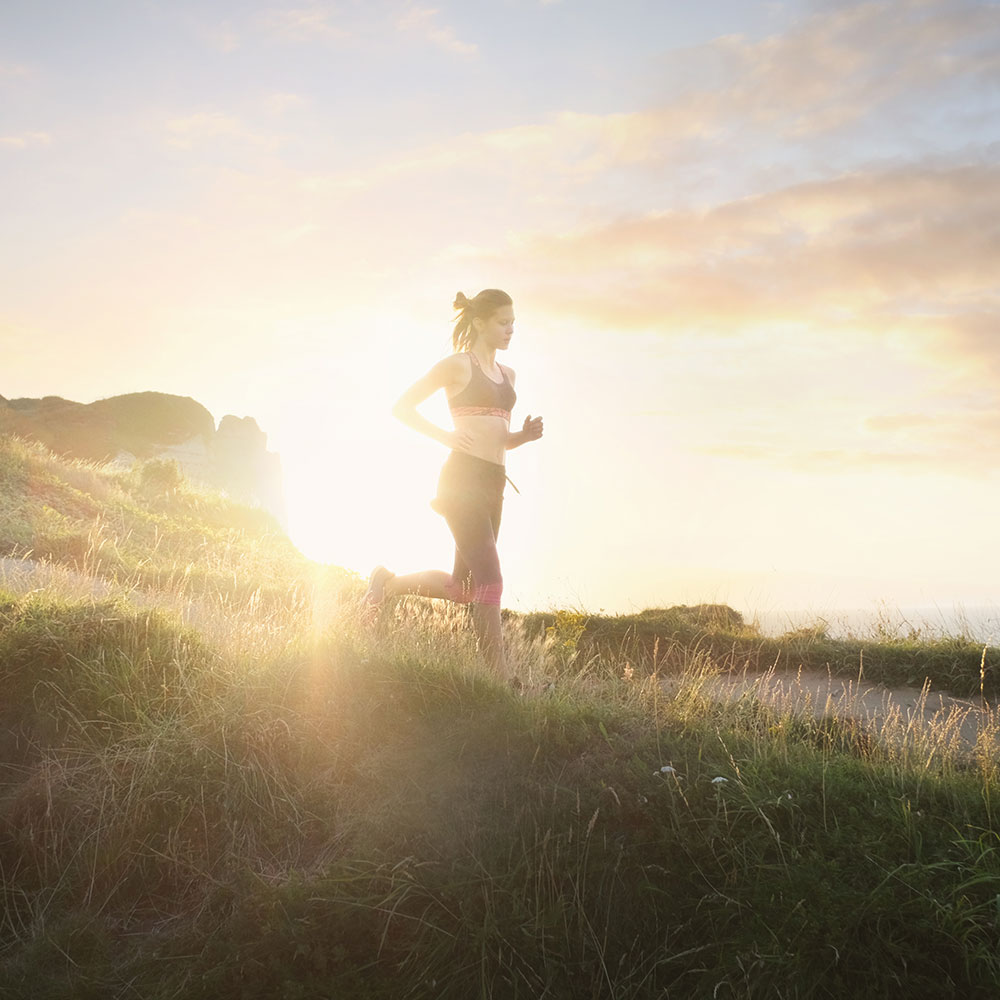 woman running outside for running benefits