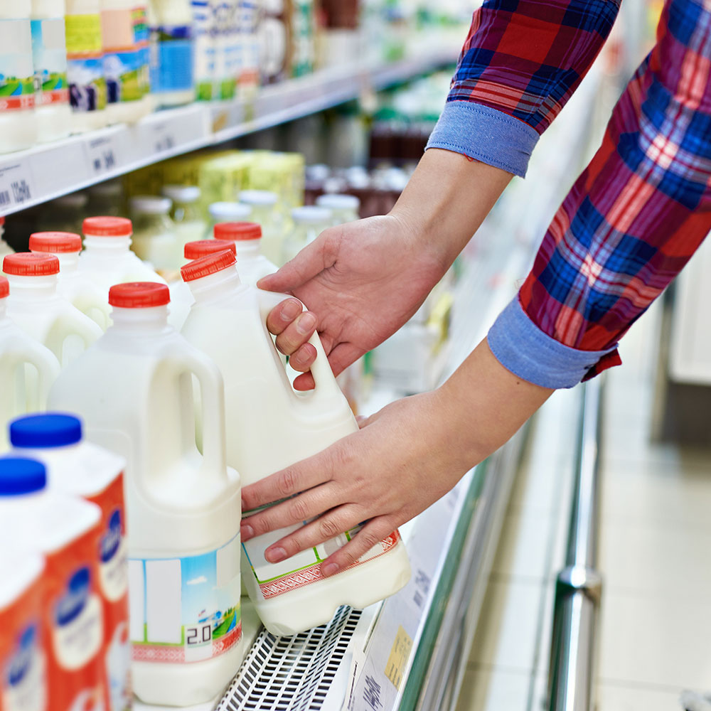 woman buying milk processed foods