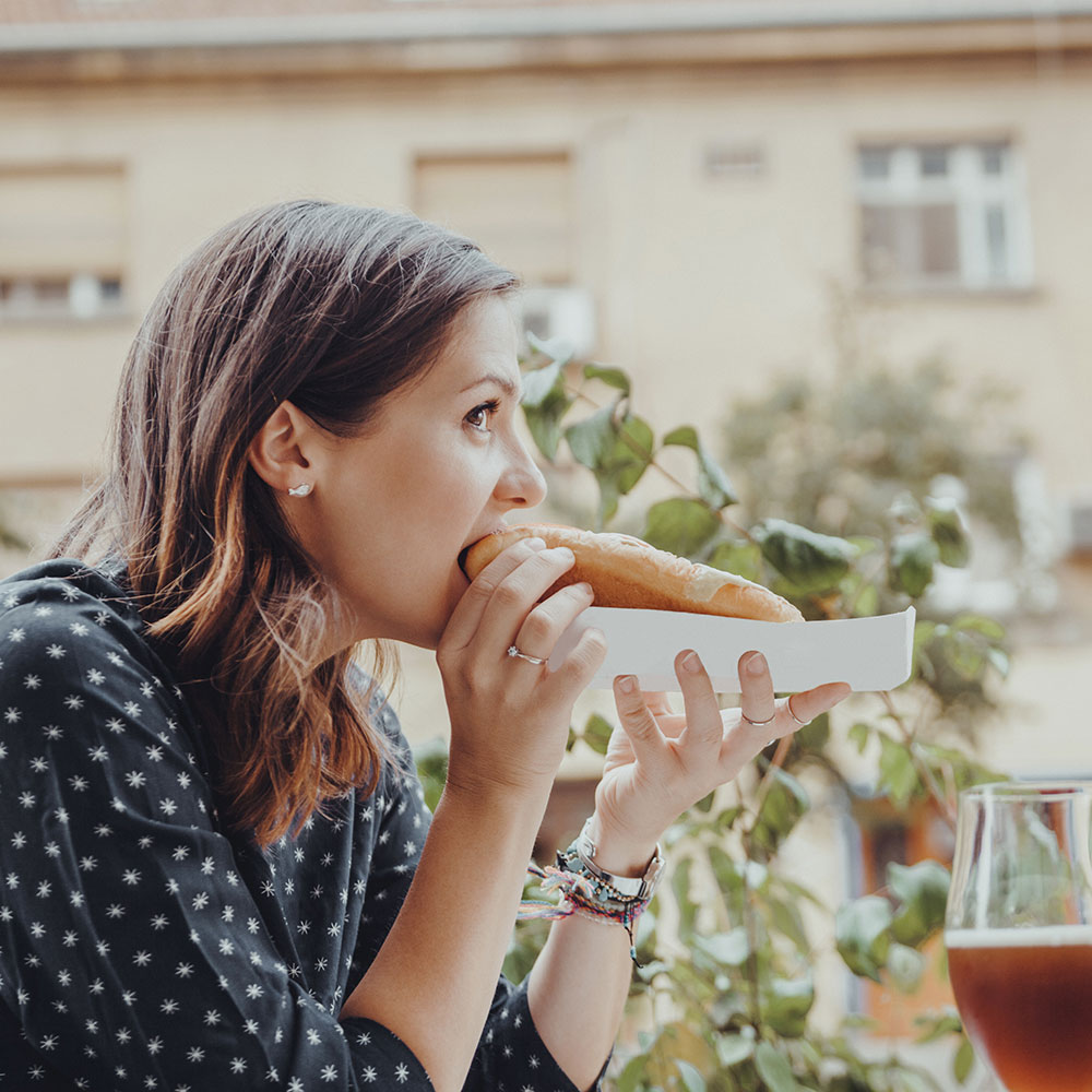 how bad is processed food in clean eating diet woman eating hot dog