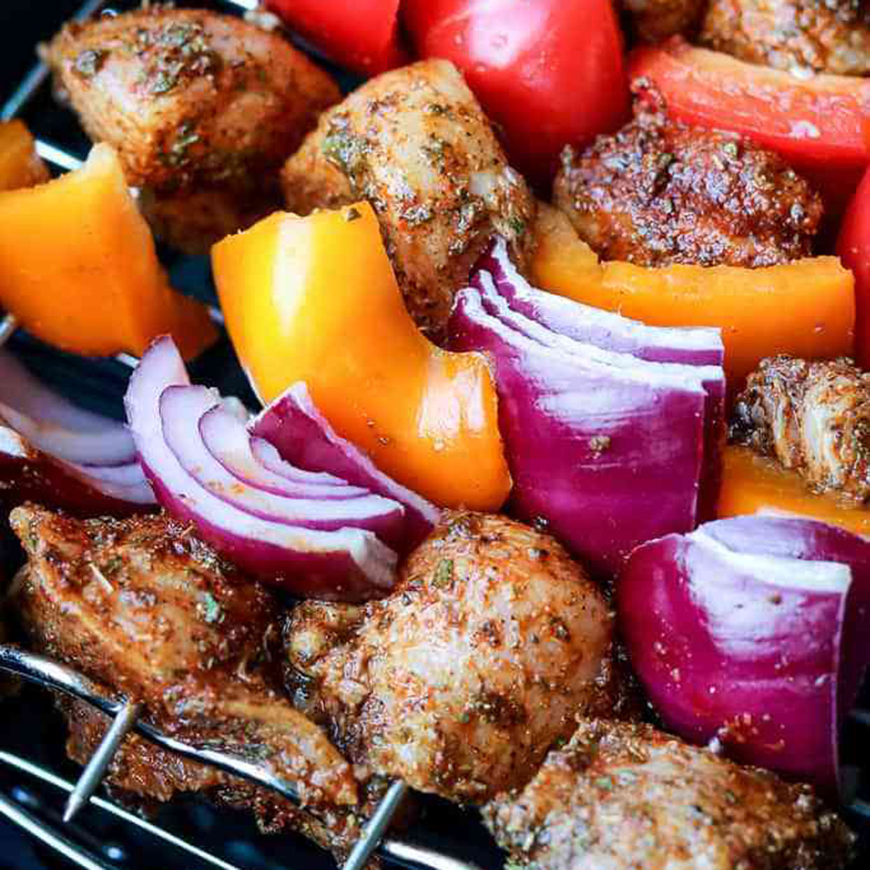 In addition to the chicken, the air fryer also perfectly cooks the orange and red bell peppers and onion chunks. Eat these kebabs solo or put into a tortilla with salsa and cheese to make a taco.