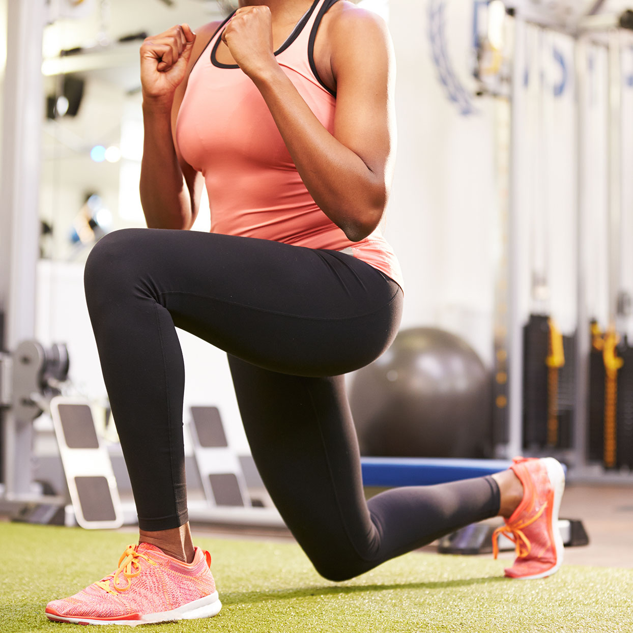 A woman does a lunge exercise