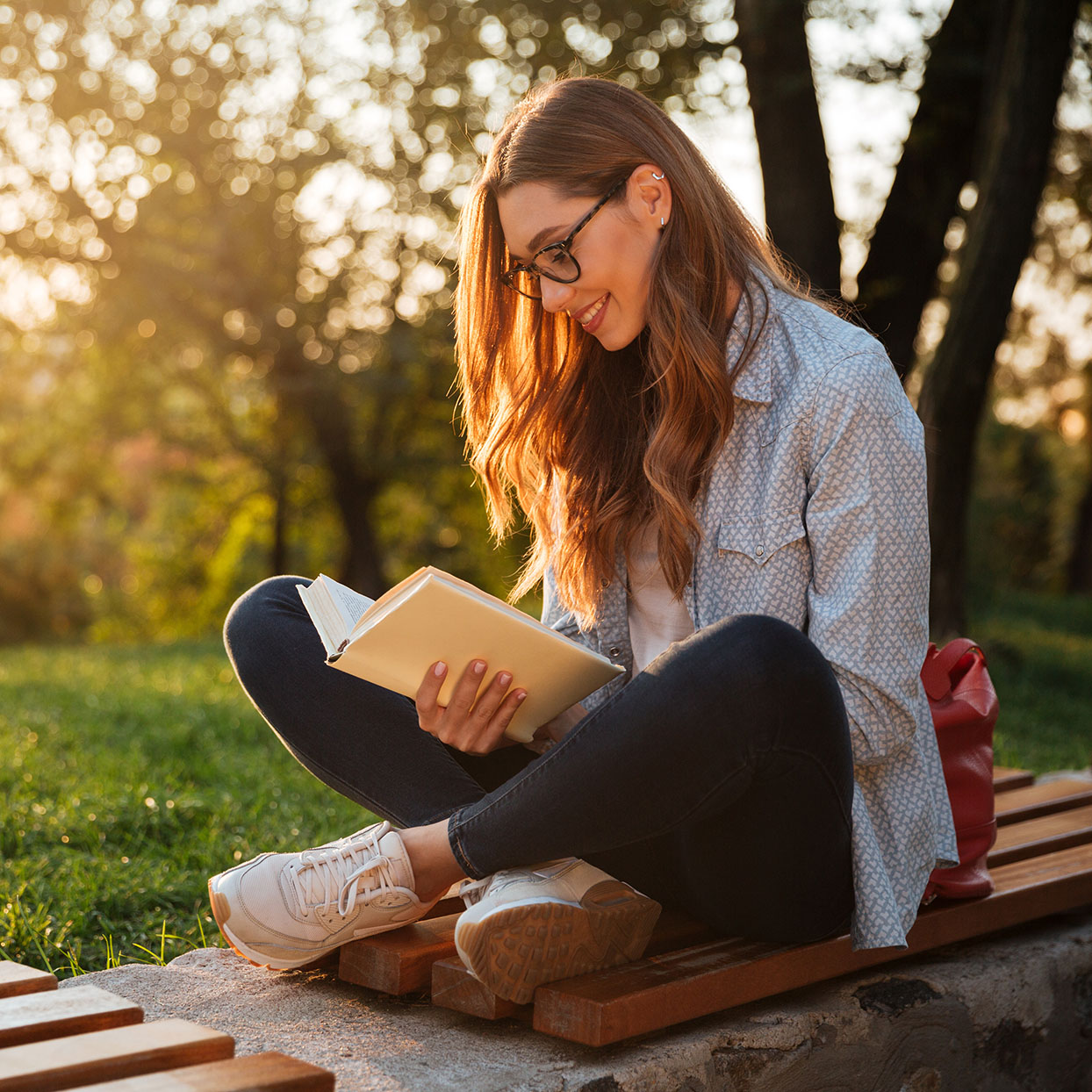 A woman smiles while reading