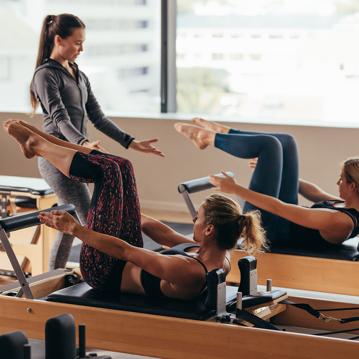 Pilates benefits can be realized by using a reformer at a class.