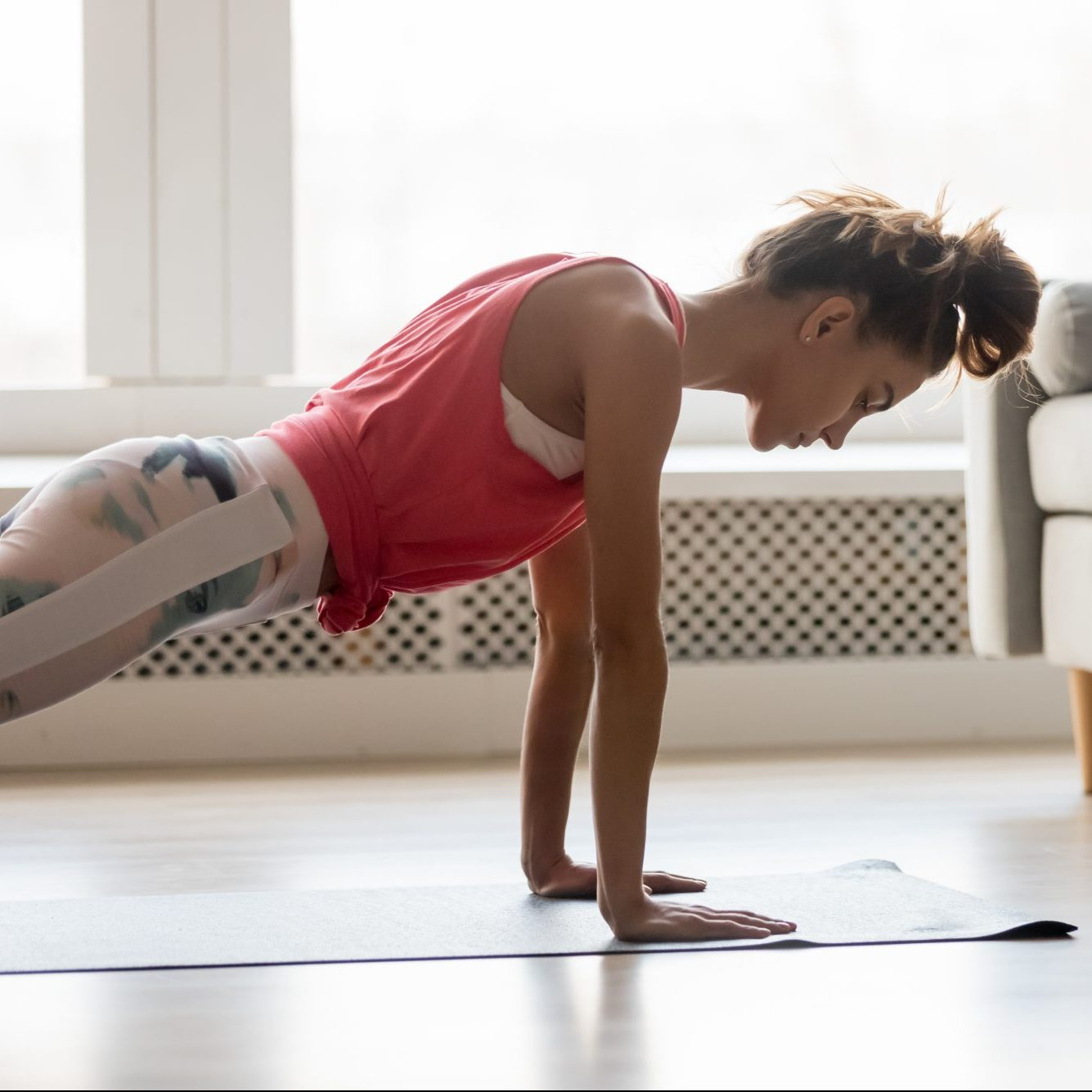 woman-doing-bodyweight-cardio-workout-at-home