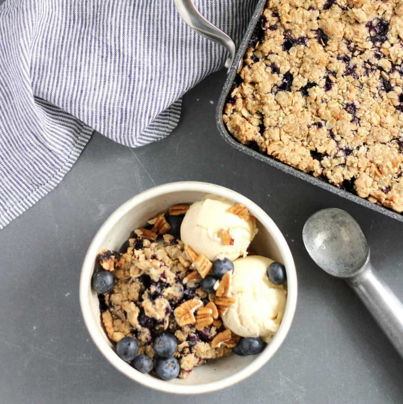 Everyone gets hit with a sweet craving every once in a while, but there's no reason those indulgent treats can't add some nutrition to your day. (BTW, here's exactly how one woman finally curbed her intense sugar cravings.) Like other oat desserts, this recipe features a combination of fiber, plant-based protein, and fats that balance the nutrition to avoid a blood sugar rollercoaster. Using warm baking spices with blueberries boosts the antioxidant content, and a hint of citrus blends all the flavors together into a delicious baked crumble.