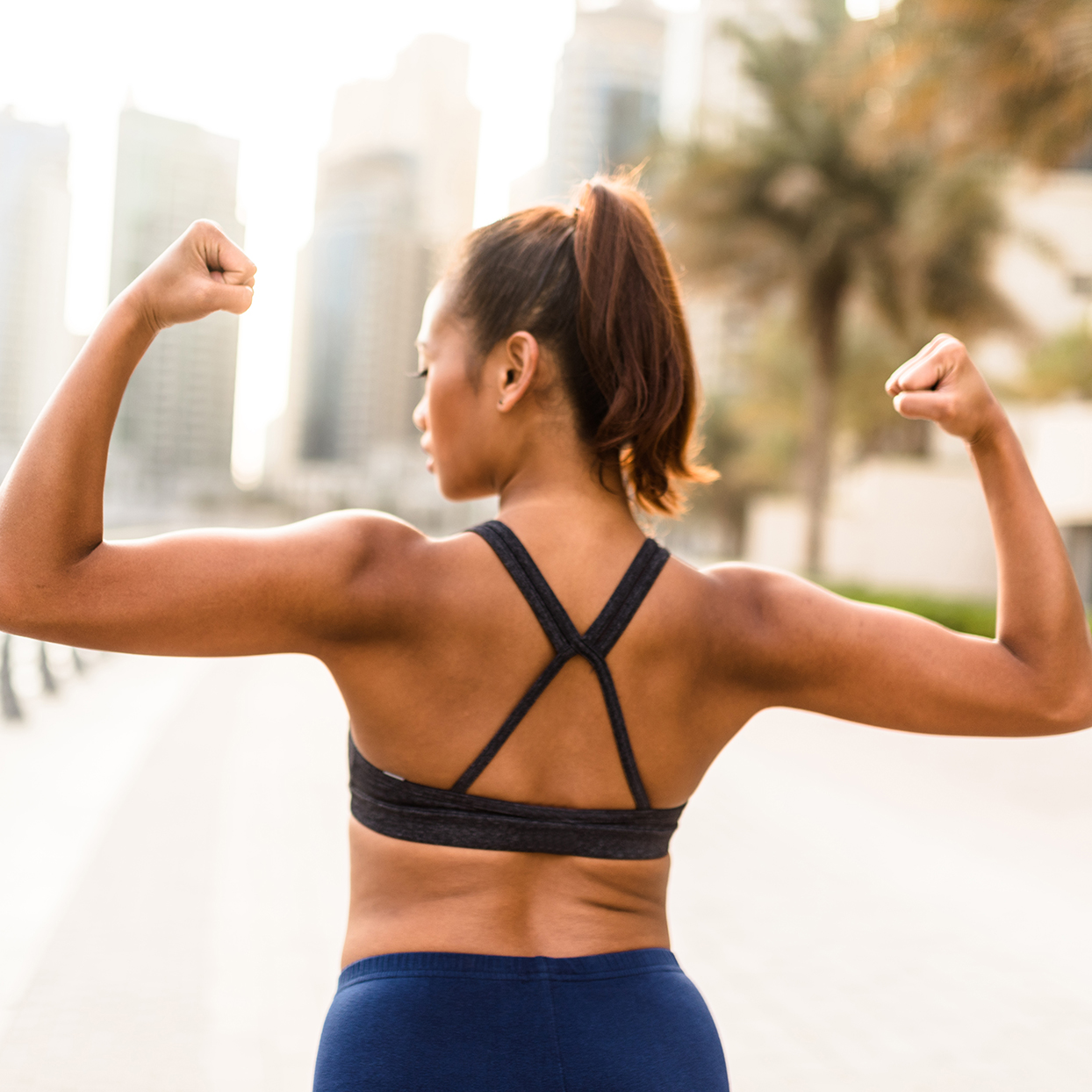 woman showing the muscle