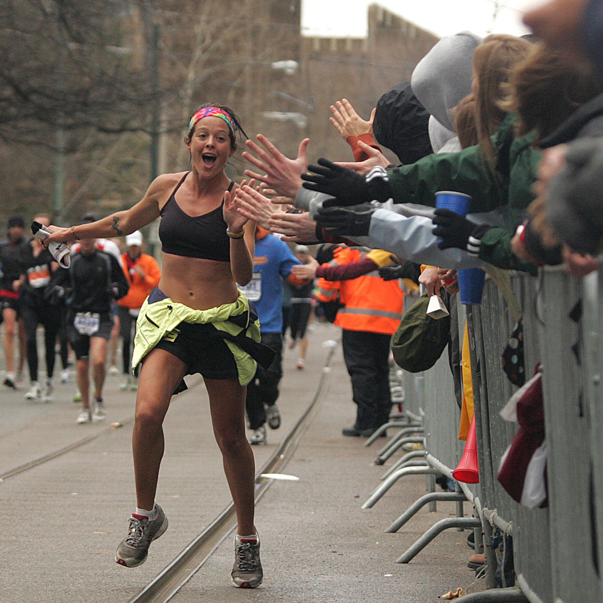 Woman_Marathoner_High_Fiving_Spectators