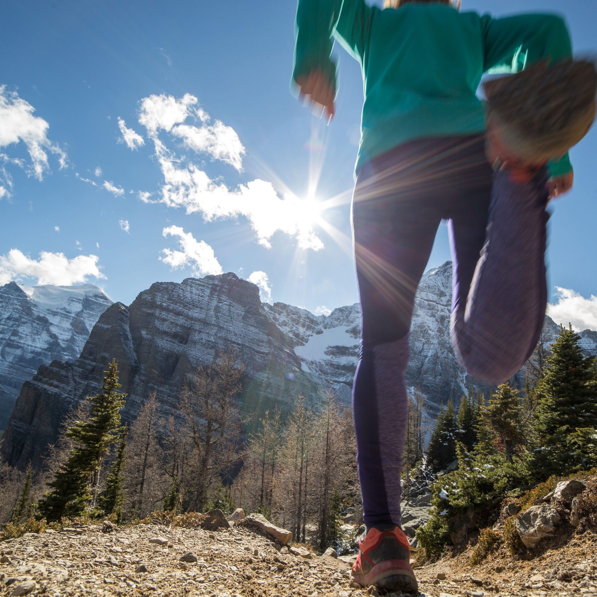 Close_Up_Of_woman's_Feet_Running_In_Mountains
