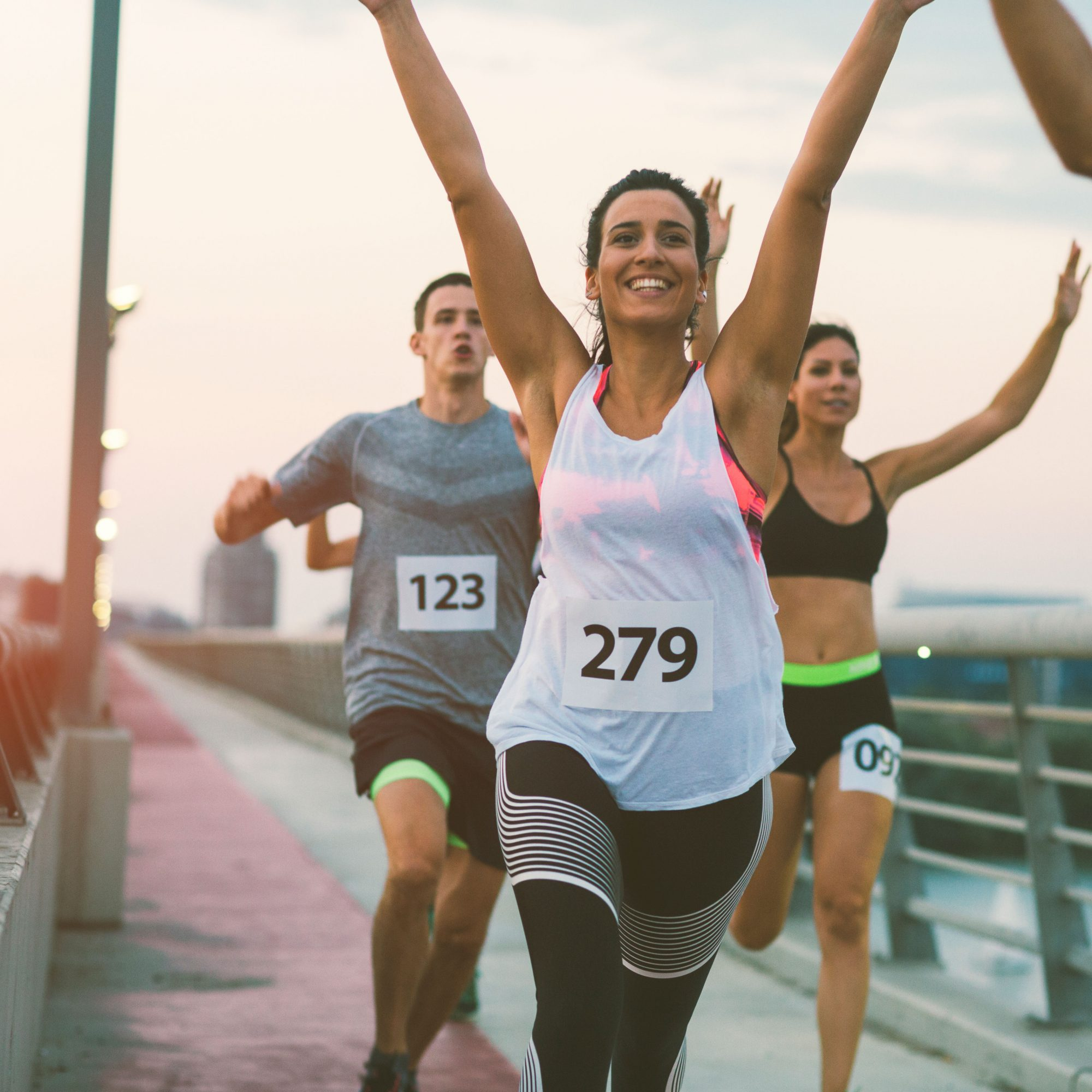 Woman_Cheering_While_Running_On_Bridge