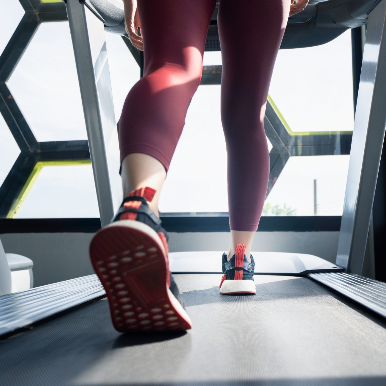 woman running on treadmill in bad shoes