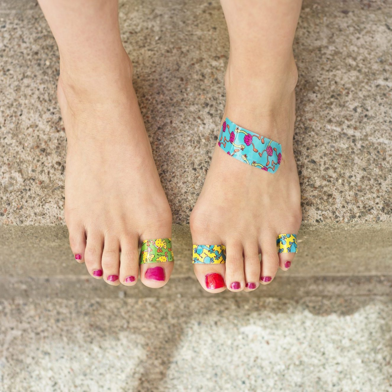 woman-with-blisters-and-bandaids-on-feet-from-running-in-bad-shoes